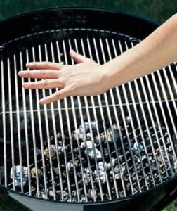 testing grill heat with hand