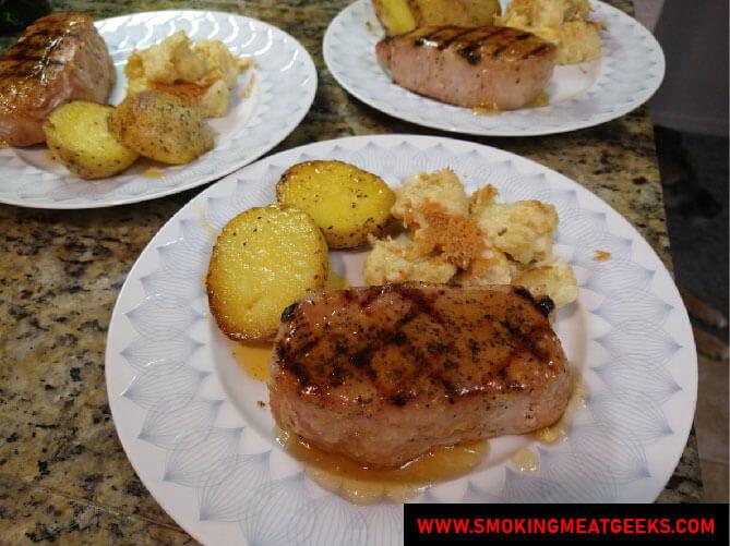 Hybrid pork chops served dish with apple gastrique