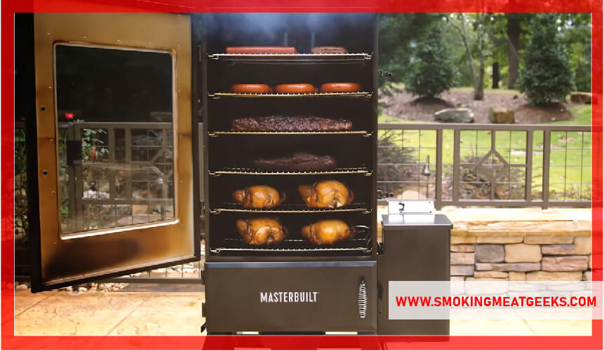 meat and chicken placed in electric smoker racks