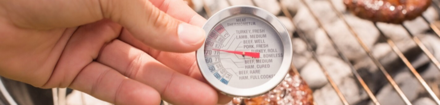 thermometer in man hand