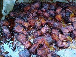 fully cooked and sauced Brisket burnt ends in pan 1