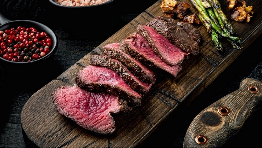 well cooked brines meat on wood tray