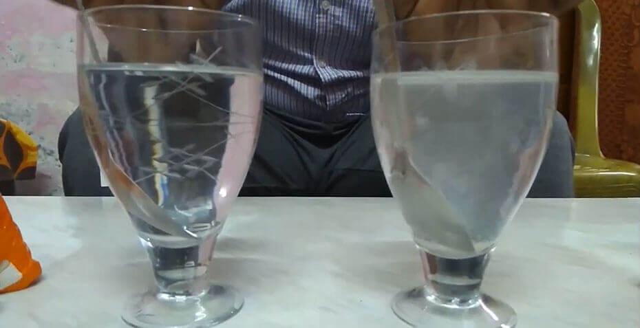 Man testing salt quality in water