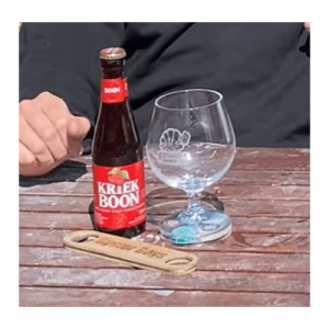cherry tang of a kriek beer Bottle with glass