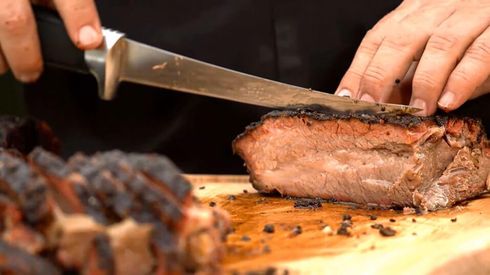 chef slicing brisket